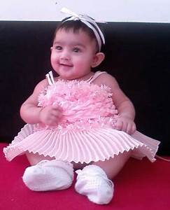 Baby girl in pretty pink dress.PNG