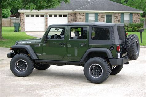 dark green jeep post your jeep green metallic with black wheels jk forum