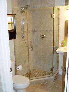tiled corner shower except with pennies on the floor of With small bathrooms with corner showers