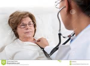Doctor Examining Patient Bed