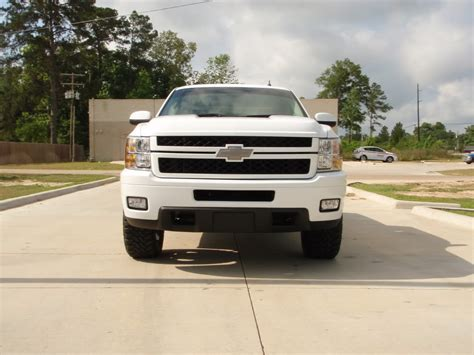 2010 chevy silverado with hd front end on 24 dub wheels 2010 white silverado crew cab 2011 hd front end 22s 33s