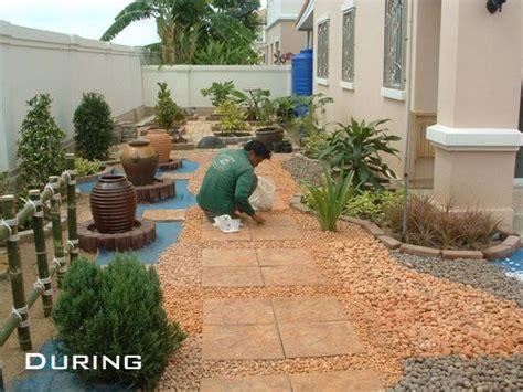 forget grass   install  pebble rock garden