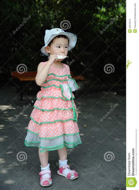 Chinese Child Eating Ice Cream