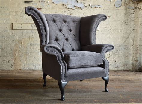 Wing Chair by Clifton Velvet Chesterfield Wing Chair Abode Sofas