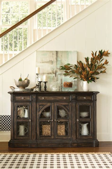 handsomely crafted  pecan solids  veneers  chapleau sideboard   classically elegant piece   enrich  space