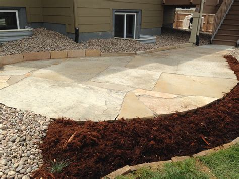 flagstone backyard colorado buff flagstone patio with really large pieces installed by glacier view landscape and