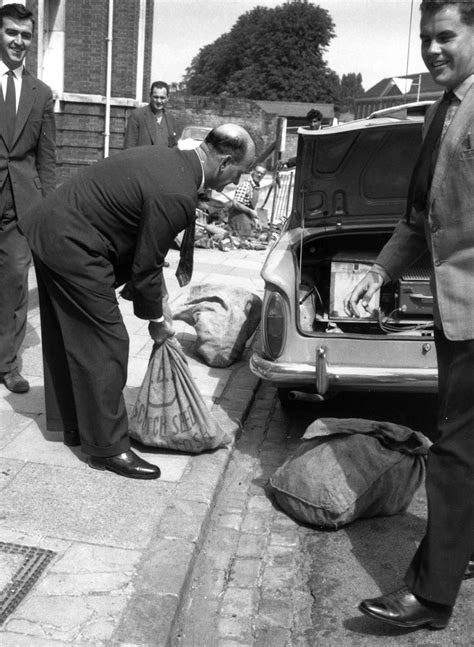 train robbery 1963 bags put evidence into police officers boot getty heist british looking britain evening reynolds standard 50th anniversary