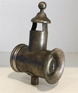 A GAS-POWERED MOTORCYCLE LAMP, CIRCA EARLY 20TH CENTURY