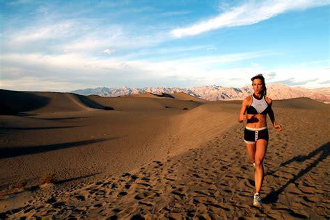 woman running sand dunes  death valley ca robert