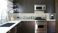 cabinet kitchen island grey tile backsplash white countertops cherry cabinets 1924