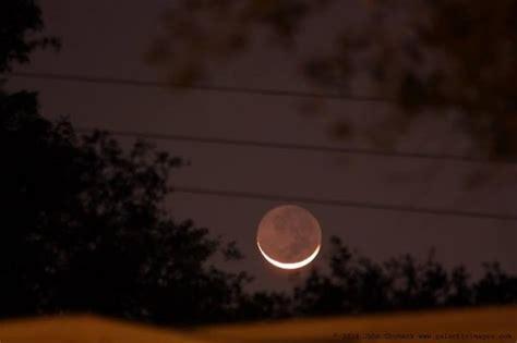 astrophotos sun halo crescent moon  earthshine