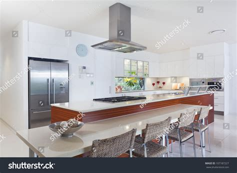 Modern Kitchen With Stainless Steel Appliances In Rechargeable Led Light Briese Ceiling Covers Coors Fridge Wine Bottle Pendant Strip Lights Green Laser Prostate Surgery Side Effects Apps