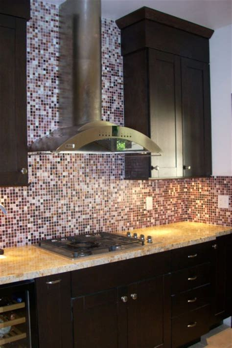 dark oak cabinets  glass tile backsplash