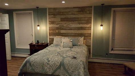 laminate wood flooring headboard used laminate flooring that looked like reclaimed barn wood headboard wall pinterest