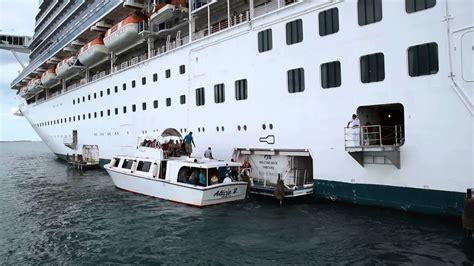 tender boat docking  cruise ship emerald princess