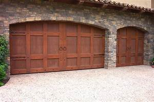 Custom wood carriage house garage doors beautiful solid for Carriage style garage doors for sale