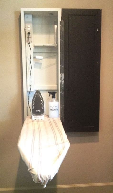 Iron Board Cupboard by Ironing Board Cupboard With Integrated Electrical For