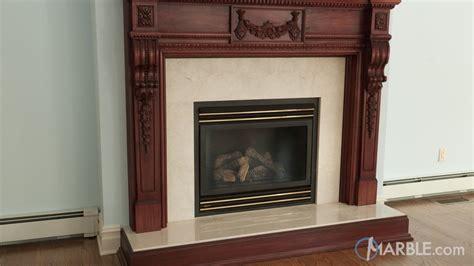 crema marfil fireplace surround