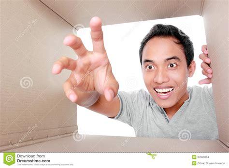 Man Trying To Take Something Inside Box Stock Images