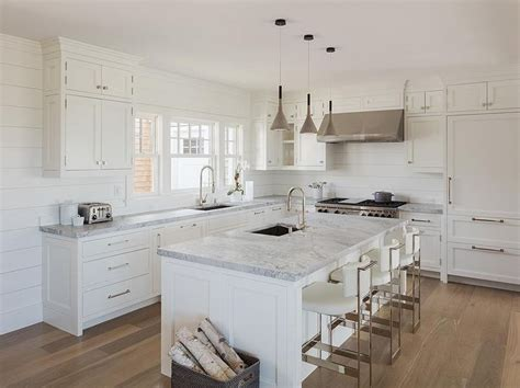 white l shaped kitchen with island chic white cottage kitchen features creamy white shaker cabinets paired with gray marble