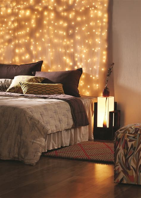 wall lights behind bed 45 ideas to hang christmas lights in a bedroom shelterness