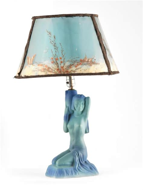 figural lamp and butterfly shade by van briggle