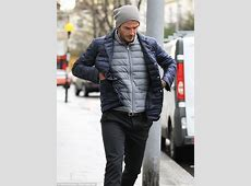 David Beckham keeps his head down as he takes solitary