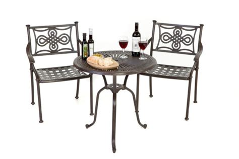 bistro set with knot chairs outside edge metal garden
