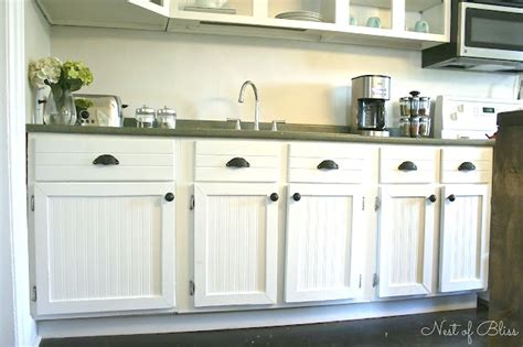 adding beadboard to kitchen cabinets budget cabinet makeover sand and sisal 7402