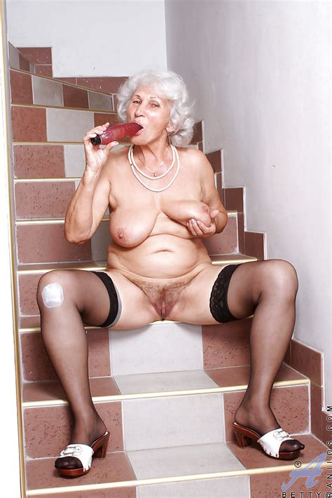 Fat Granny In Black Hold Up Stockings Squeezing A Sex Toy