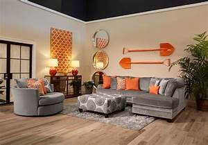 the application of orange and cool grey in this living With gray and orange living room
