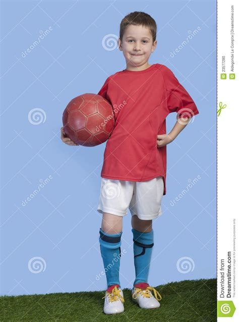 Young Boy In Outfit With Soccer Ball Stock Photo - Image 23577280