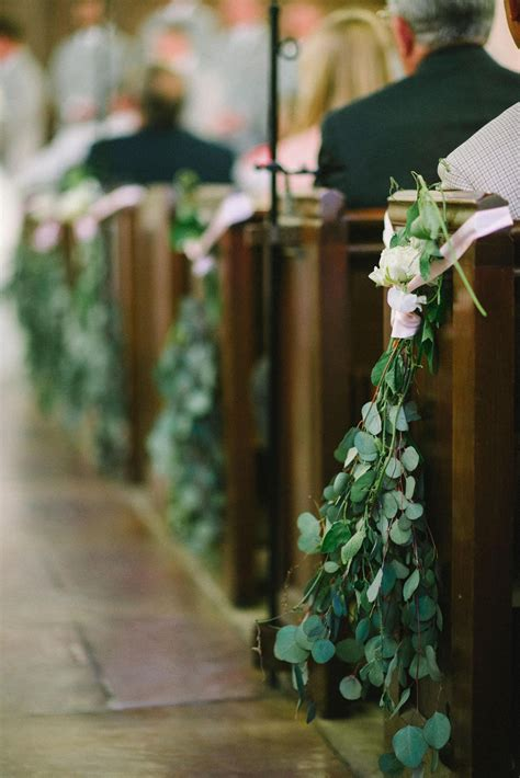 eucalyptus leaves white roses pink ribbon wedding