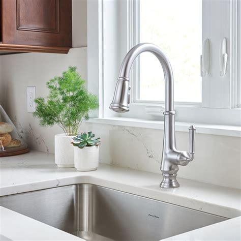 what are kitchen sinks made out of delancy pull kitchen faucet american standard 9830
