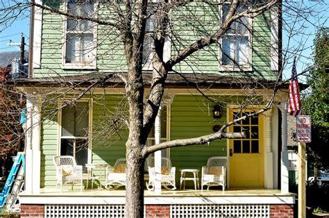 full image  yellow door  green house exterior