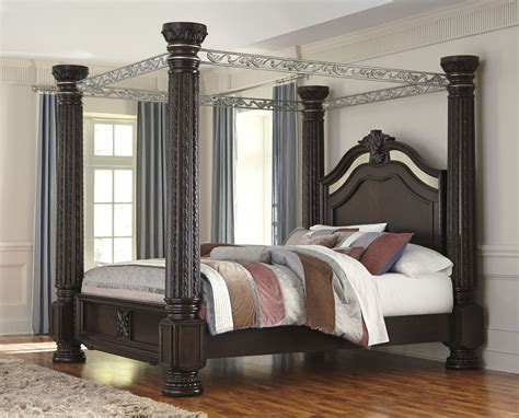 california king poster bedroom sets laddenfield cal king poster canopy bed b717 50 51 62 72