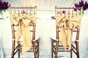 wedding chairs for and groom wedding reception groom chairs gold bows onewed