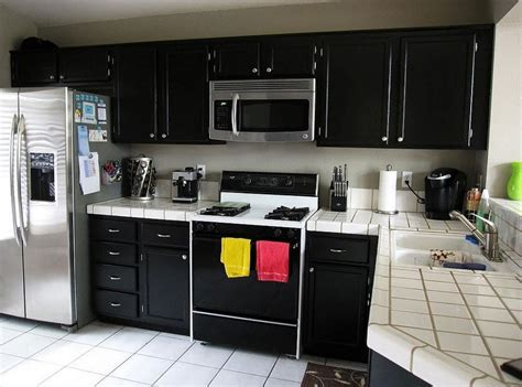 small kitchens with dark cabinets white ceramic countertop and corner black cabinet for