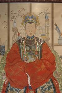 a pair of framed ancestor paintings lotus