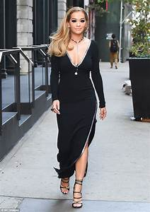 Rita Ora wows in plunging black dress as she steps out in ...