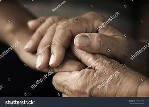 Hands Of An Elderly Woman Holding The Hand Of A Younger ...