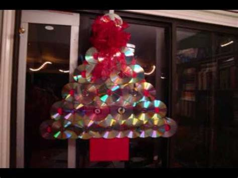 who to make a christmas tree from old tires how to make a tree door decoration with compact discs