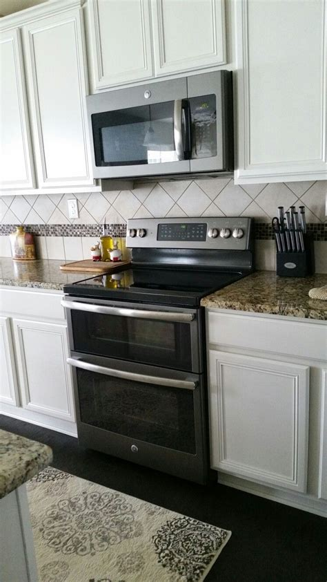 grey kitchen cabinets with white appliances ge slate appliances with antique white cabinets our 8361