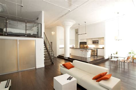 Interiors Riverside Penthouse Features Modern Mezzanine With Glass Railing Also Revessed Lights