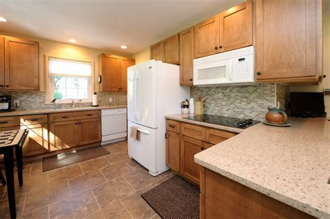kitchens with white appliances and oak cabinets great northern cabinetry kitchen traditional kitchen 9860
