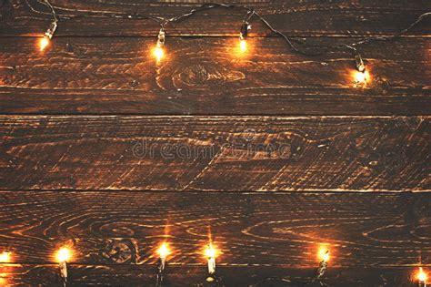christmas lights bulb  wood table stock photo image
