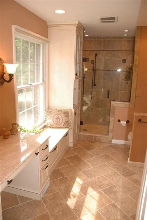 traditional bathroom  light tan tile shower wall