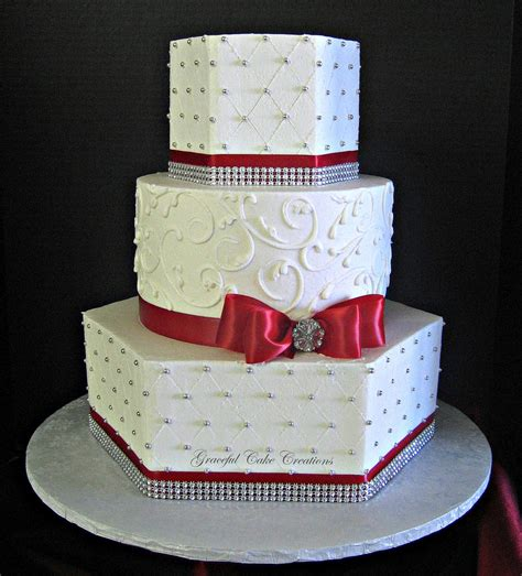 Elegant White Buttercream Wedding Cake With Red And Silver