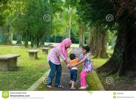 Asian Children Playing At Outdoor Stock Image  Image Of
