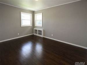 Graywallsanddarkwoodfloor grey wallswhite molding for White baseboards with wood floors